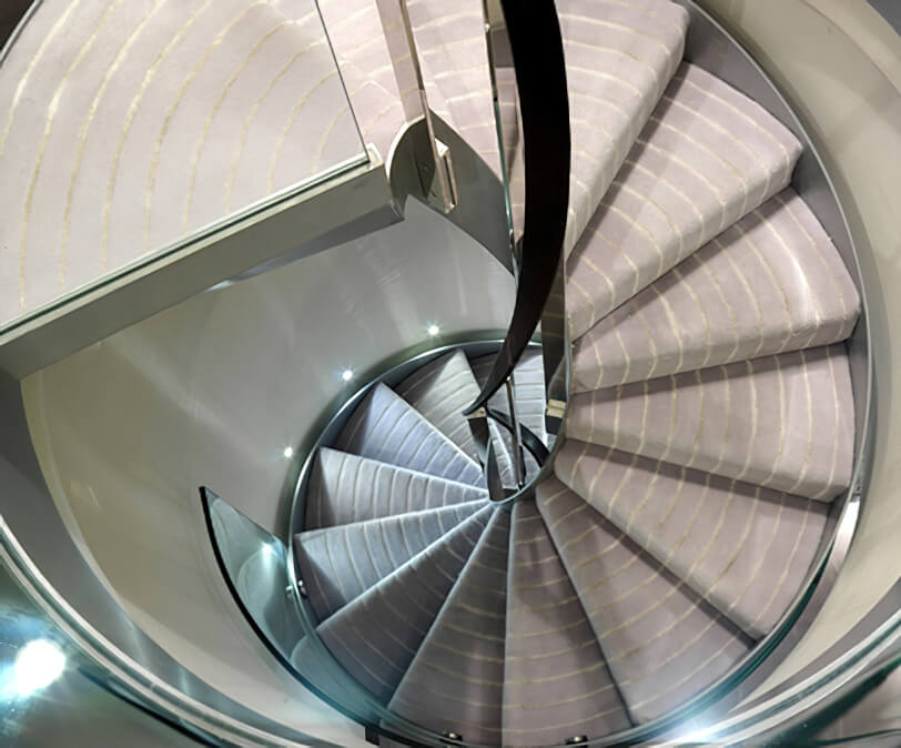 Spiral staircase with silk stripes.