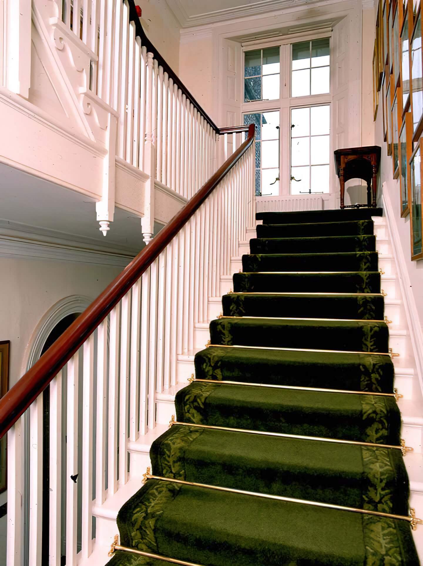 West Dean staircase carpet with a special border design taken from an old rug designed by Voysey which was discovered in the attic by David Mlnaric and adapted by Rob Holmes.